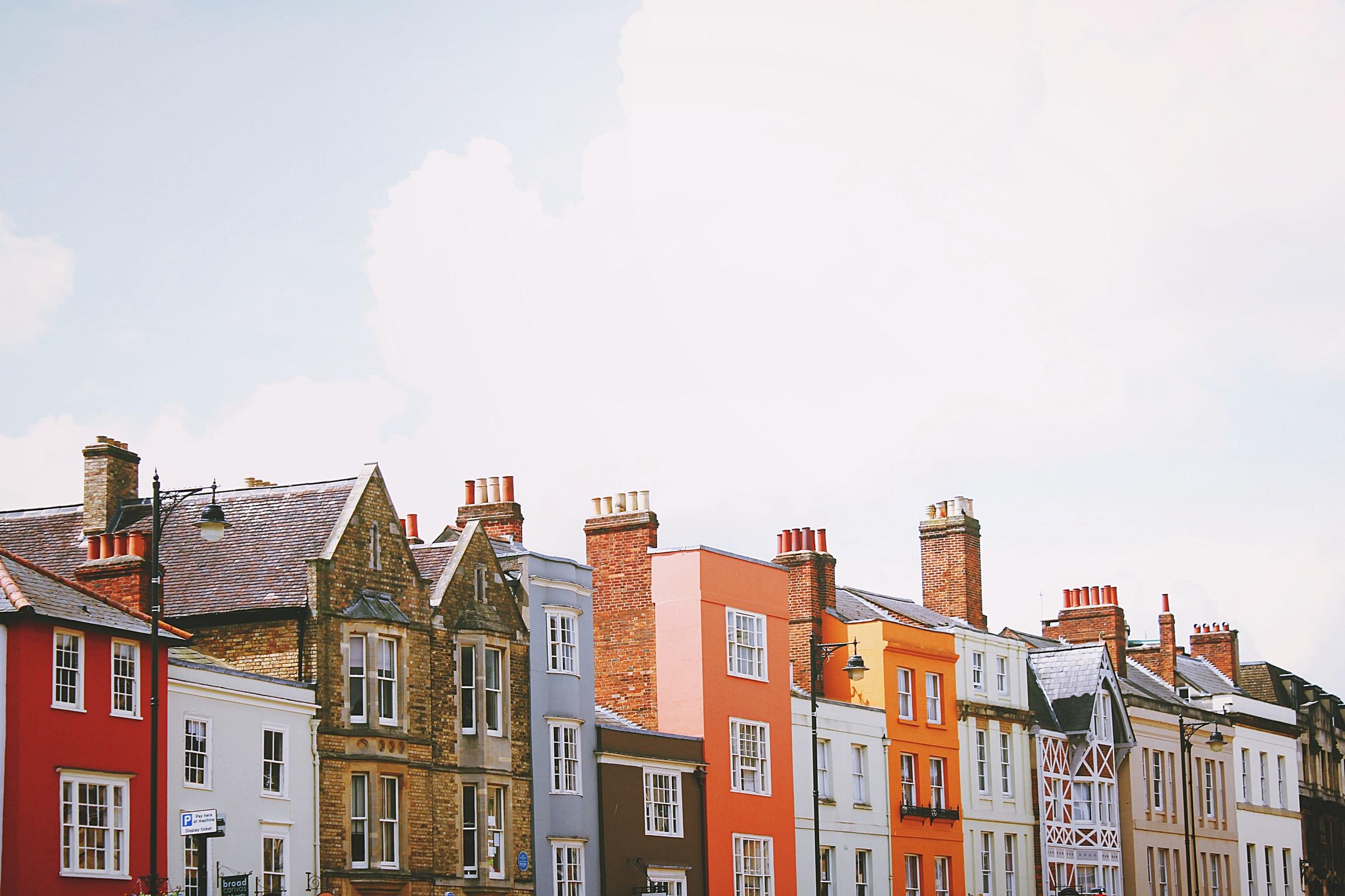 Row of houses/ toa-heftiba Unsplash