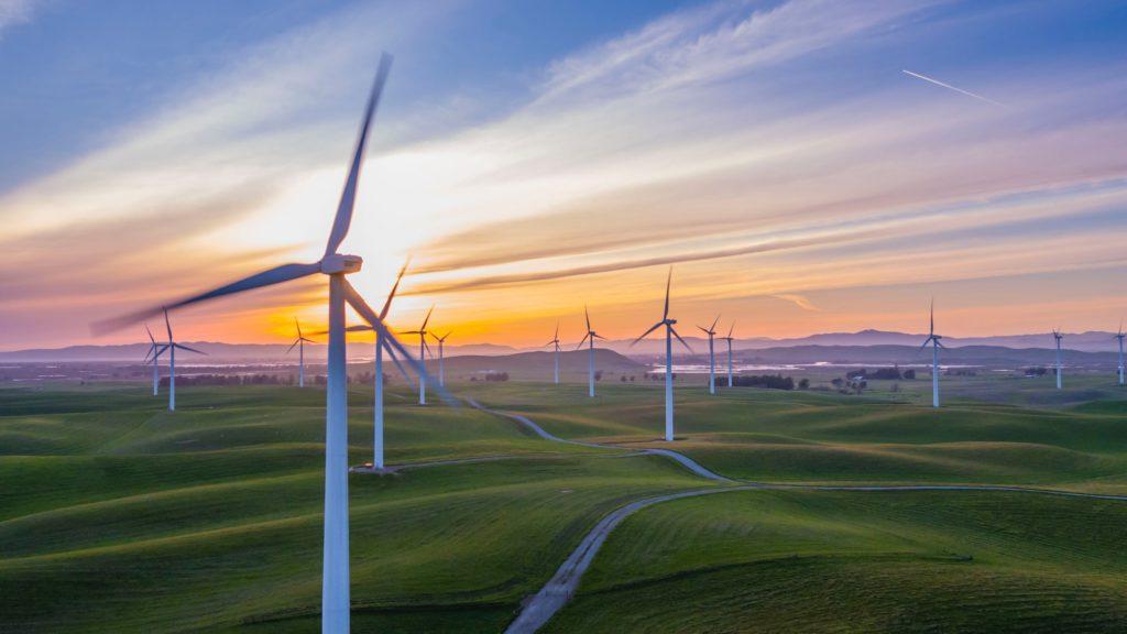 Wind farm on hilly grasslands/ CC0 Rawfilm