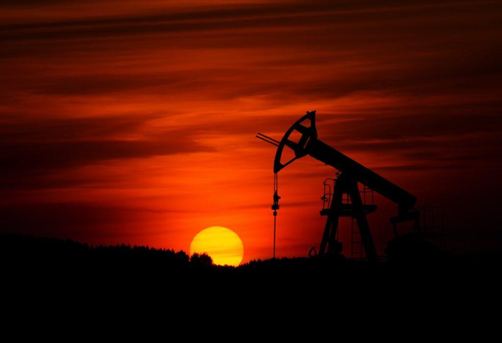 Pumpjack against orange sunset/ CC0 Zbynek Burival