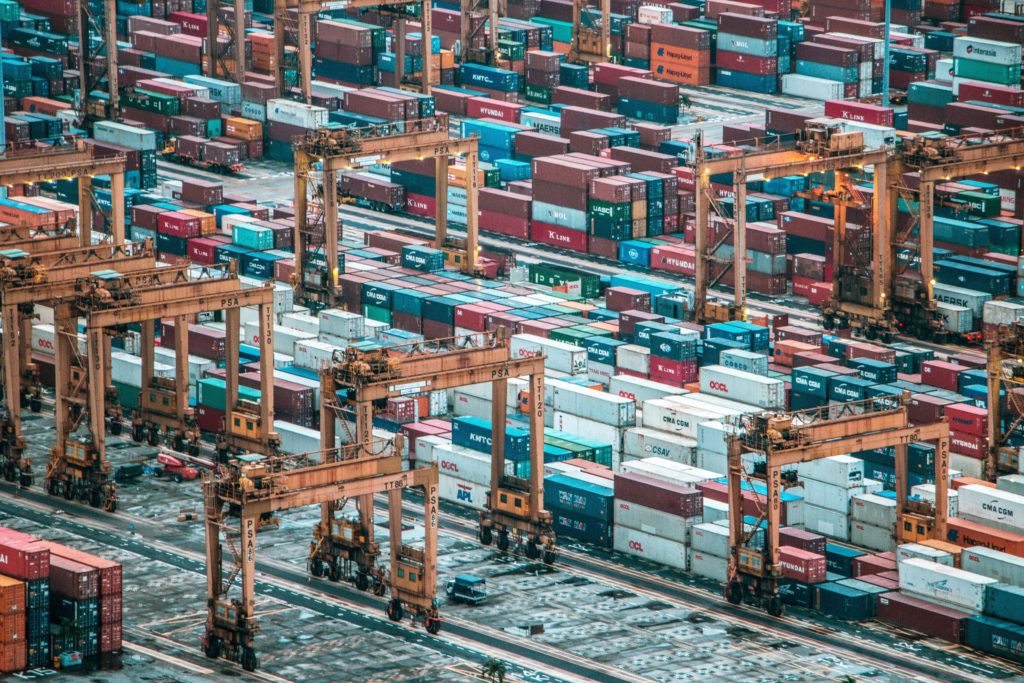Shipping containers and cranes/ CC0 Ammiel JR