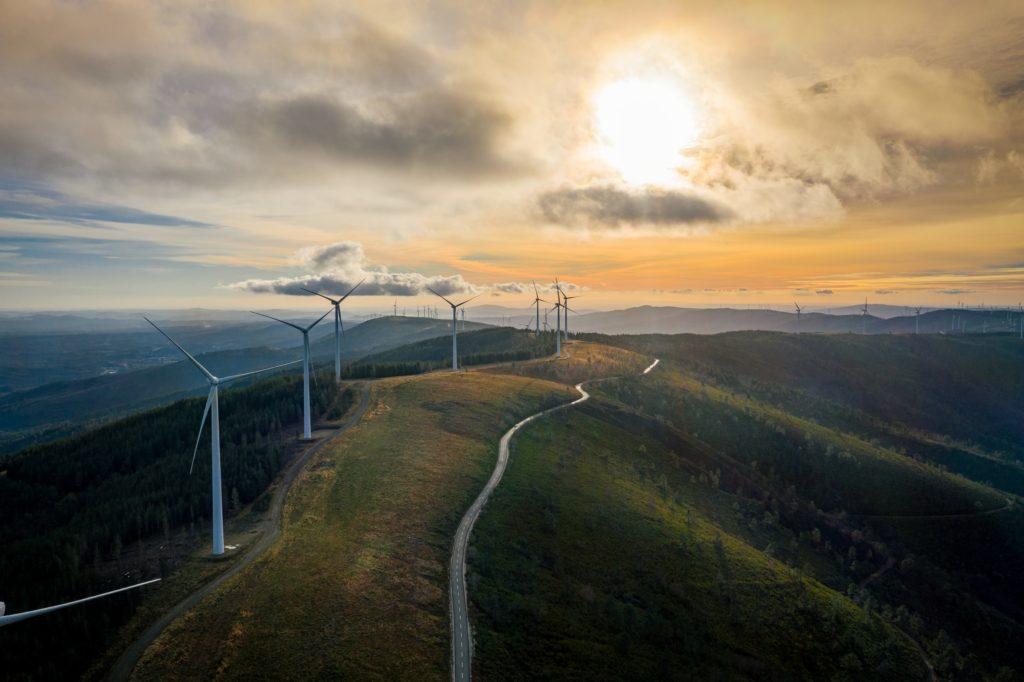 Wind turbines on hill ridge/ CC0 Nuno Marques