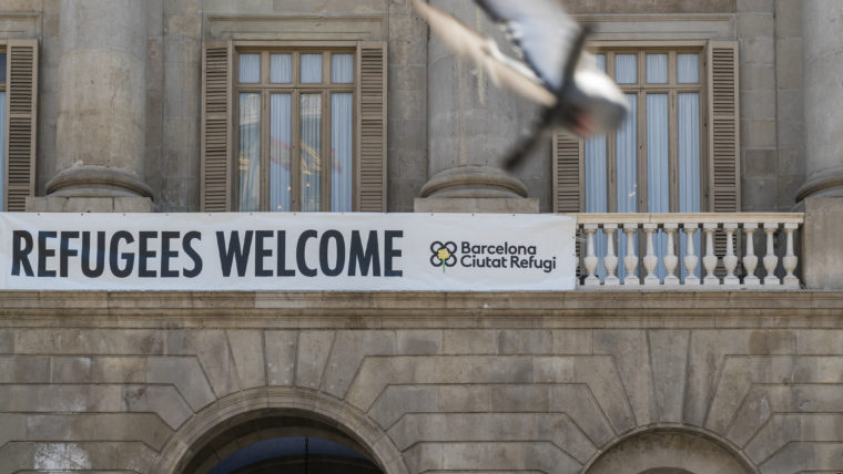 Refugees Welcome sign on Barcelona's city hall balcony