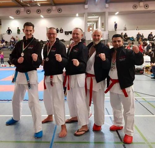 Thaer Jafar with his karate team mates