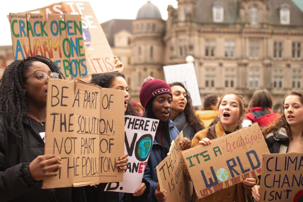 Group of women holding signs/ CC0 callum-shaw