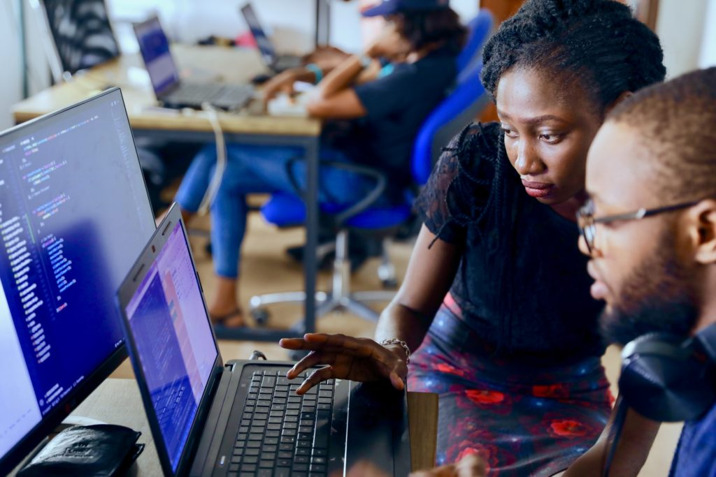 Woman and man working at computer/ CC0 lagos-techie